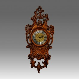 211/1 Wall Clock in solid hand-curved wood, walnut finishing.
